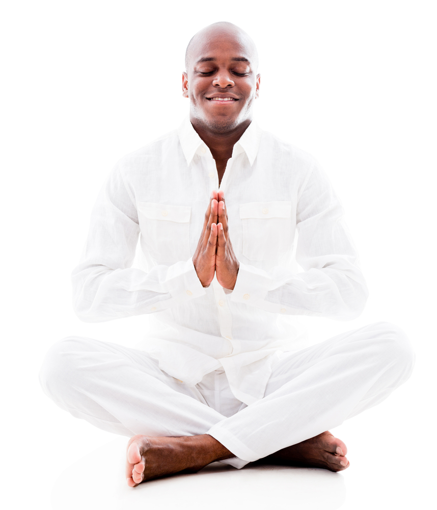 Peaceful man doing yoga exercises - isolated over a white background